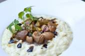 Kidneys and risotto — Stock Photo