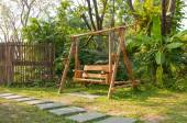 Wood swing bench in a park — Stock Photo
