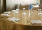 Tables set for dinner — Stock Photo