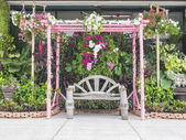 Beautiful bower in front of building — Stock Photo