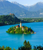 Christian church on island, lake and mountains background at Bled, Slovenia — Stock Photo