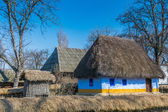 Authentic Romanian village house covered with straws and built with natural bio materials in traditional architecture — Stock Photo