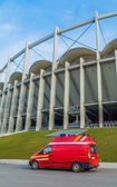 Emergency medical rescue van parked near the modern building of National Arena in Bucharest — Stock Photo