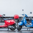 Blue and red scooters over blurry white track symbol of blue, white and red France flag — Stock Photo #71552495