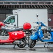 Blue and red scooters over blurry white track symbol of blue, white and red France national flag — Stock Photo #71552671