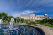 IASI, ROMANIA - 23 MAY 2015: Iasi Cultural Palace being restaurated with a beautiful green park on a sunny spring day with dramatic sky on background — Stock Photo