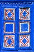 Texture - closeup detail of blue painted window shutter. — Stock Photo