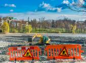 Yellow excavator doing lake cleaning and maintenance services under municipality authority  in a park — Stock Photo