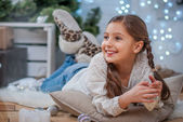 Girl with Christmas decorations — Stock Photo