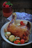 Baked chicken leg with mushrooms and tomatoes — Stock Photo