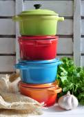 Four little colorful cooking pots — Stockfoto