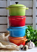 Four little colorful cooking pots — Stock Photo