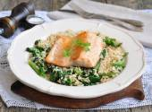 Fried salmon with brown rice, spinach and leguminous kidney bean — Stock Photo