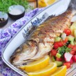 Fried fish served with mashed potato, lemon slice and vegetables salad — Stock Photo #69719453