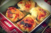 Roasted chicken thighs on a wooden table.selective focus.image is tinted — Stock Photo
