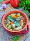 Fresh vegetable soup with bean, carrot, potato, tomato in bowl — Stock Photo