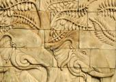 Close up stucco carved wall depicting elephants  — Stock Photo
