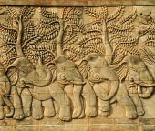 Stucco carved wall depicting 5 elephants  — Photo