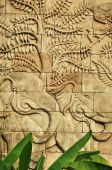 Stucco carved wall depicting elephants — Stock Photo