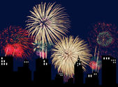 Bursts of fireworks over silhouette of city — Stockfoto