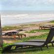 Rattan couch chairs in front of the sea — Stock Photo #64850223