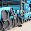 blue PVC water pipes in the storage — Stock Photo #64852399