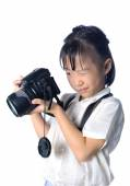 Portrait of asian little girl holding photo camera — Stock Photo