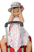 Little asian girl in a weave hat and sunglasses sitting on a hug — Stock Photo