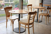 Wooden chair and table in cafe near glass wall — Stock Photo