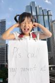 Asian little girl get lost with parent information contact in ci — Stock Photo