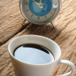 A cup of coffee with its reflection on glass of clock — Stock Photo #78101846