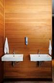 Ceramic washbasin on the wooden wall — Stock Photo