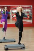 Step aerobics in gym with dumbbells — Stock Photo