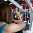 One girl watching another doing exercises in gym — Stock Photo #61991739