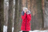 Happy smiling female in red winter jacket talks on mobile phone, — Stock Photo