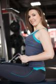 Portrait of smiling girl on training apparatus — 图库照片