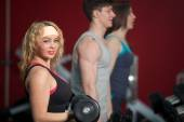 Group of people training with freeweights in fitness center — Stock Photo