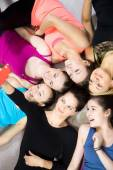 Group of beautiful sporty girls taking selfie, self-portrait wit — Stock Photo
