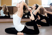 Two yogi female exercising in class — Stock Photo