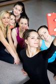 Group of beautiful sporty girls posing for selfie, self-portrait — 图库照片