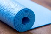 Folded blue yoga mat — Stock Photo