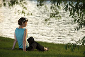 Young woman resting on the riverside — Stock Photo