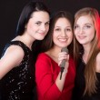 Three beautiful girls with microphone — Stock Photo #69729895