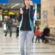 Girl talking on phone in airport — Stock Photo #74151469