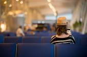 Young traveling woman waiting for transport — Stock Photo