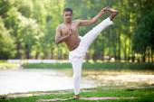 Yoga practice on riverbank — Stock Photo