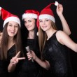 Three attractive young santa girls with microphone — Stock Photo #77700856