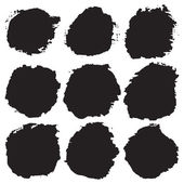 Scratched blots of black paint — Stock Vector