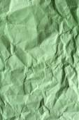 Green crumpled paper for background — Stock Photo