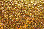 Holiday yellow glitter — Stock Photo
